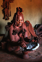 Himba, cleaning kit - Namibia (kryyslee) Tags: world pictures voyage africa trip travel red woman plants color travelling colors lady canon southafrica rouge photography eos photo tour image herbs photos earth couleurs smoke femme picture images du cleaning traveller clean adventure explore ashes terre around kit tribe christophe monde backpacker amateur seen pict namibia autour couleur mixture plantes himba afrique worldtrip tribu globetrotter fumee aroundtheworld aventure cendres namibie tourdumonde 50d aroundtheworldtrip 400d himbas eos400d 20072008 excellentphotographerawards kryyslee christophepaquignon paquignon theperfectphotographer goldstaraward voyageautourdumonde