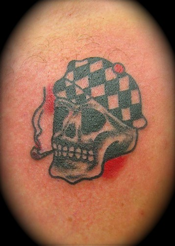 old school chekerhat skull tattooed by johannes skindeeplove please do not