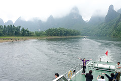 Tourist showing another tourist how to pose on the Li River in Guilin