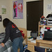 Student Cleaning Bedroom in Anacapa Village