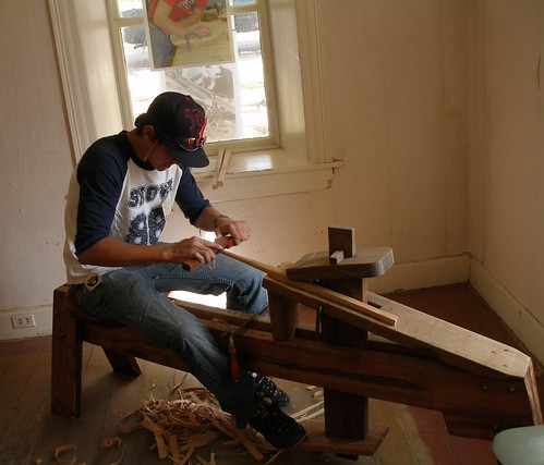 Traditional Building Skill in Action: Gage Olson uses traditional woodworking tools.