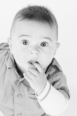 Dominic (Sergiu Bacioiu) Tags: baby white black cute monochrome hat studio blackwhite little sweet expression background small young highkey isolated dominic alexandru
