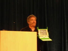 Alan Kay showing the $100 laptop ($150 currently)