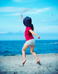 Throwing sand is so much fun! (Marta Potoczek) Tags: color beach girl jumping sand acr d200 cp throwing actions martas 3570mm dazzler preset aplusphoto