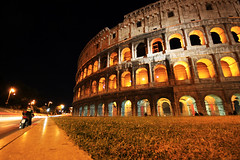Colosseo (` Toshio ') Tags: longexposure italy rome roma building history night ancient europe italia vespa roman colosseum lighttrails moped europeanunion colosseo toshio supershot superaplus aplusphoto superhearts aphotocontest34