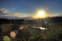 Wrekenton Sunset HDR (charminbayurr) Tags: blue trees sunset england sky orange sun green water leaves clouds reflections golf newcastle lens pond gateshead course flare rays hdr wrekenton 3xp