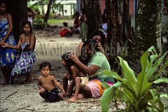 50008541 (wolfgangkaehler) Tags: boy beach children native micronesia oceania youngboy villagescene nativepeople nativewomen nativechildren carolineislands nativeboy nativewoman nativechild pulap carolineislandsmicronesia nativeislander pulapisland pulapislandmicronesia nativewomanchild nitpickinglice