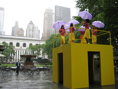 Walk The Walk Yellow Cube Kate Gilmore 0700 (Brechtbug) Tags: park new york city nyc art public fountain rain yellow by with near kate walk library performance cube behind piece bryant umbrellas gilmore the in 5122010