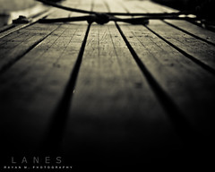 Lanes (Rayan M.) Tags: wood bridge blackandwhite abstract macro monochrome closeup marina docks wooden track secret passages tie knot pointofview tied shipyard passage lanes                  rayanmphotography