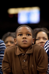 young boy listens to President Obama Speak in Cleveland