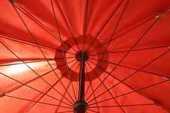 Under the Umbrella (Kathy~) Tags: red italy orange june tag3 taggedout umbrella tag2 tag1 cw 2007 mywinners anawesomeshot superhearts photofaceoffwinner pfogold fotocompetition fotocompetitionbronze challengew herowinner