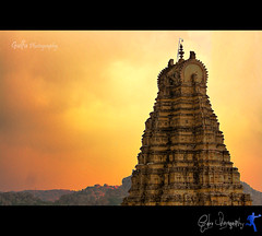 @ Hampi (Gulfu) Tags: travel canon evening is indian hill prayer karnataka 70200 f4 hampi vijayanagara virupakshatemple 1000d templesunset gulfuphotography