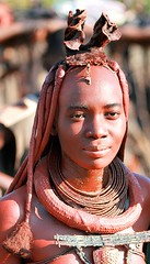 Himba woman, peacefull look - Namibia (kryyslee) Tags: world pictures voyage africa trip travel red portrait people woman travelling face look canon collier hair rouge photography eos photo necklace gesicht tour faces image photos pics earth femme picture culture peaceful images tribal du adventure safari explore round terre around tribe christophe monde backpacker amateur pict namibia colliers autour tribo indigenous visage necklaces regard paix himba coiffure afrique tribu aroundtheworld aventure namibie visages tourdumonde 50d tribus 400d eos400d kryyslee christophepaquignon paquignon