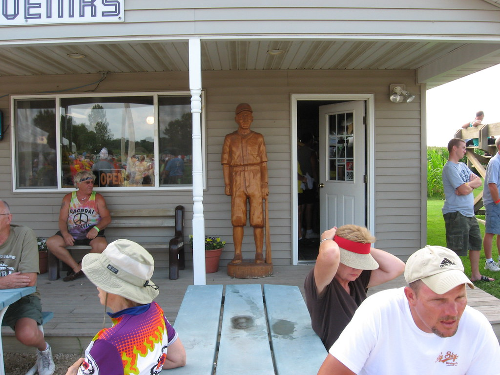 The life sized wooden period baseball player guards the door of one of the 2 souvenir stores at the Field Of Dreams set.