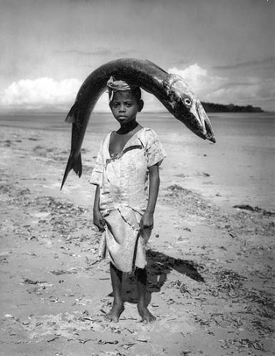 Boy carrying fish