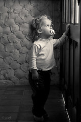 ...Juegas...? (jcof) Tags: door light bw woman blancoynegro luz window girl look ventana puerta portait bn nia lucia chupete