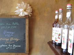 Syrups (Elena777) Tags: seattle flower coffee chalk cafe coffeeshop fremont syrup chalkboard blackboard etg paperflower espressotogo