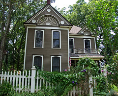 Gingerbread (Texas Finn) Tags: old windows white house detail home architecture fence wooden vines texas landscaping chocolate palestine balcony flag spice cottage victorian historic colored renovation trim twostory preservation taupe pickett blueribbonwinner