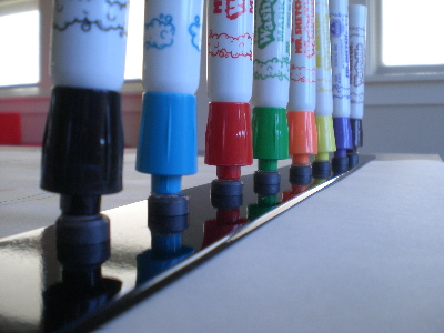 glue craft magnets onto markers