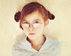 Portrait of a Girl ({amanda}) Tags: texture glasses kid serious 85mm naturallight 8years nmk amandakeeysphotography amandasactions quirkyhairbuns