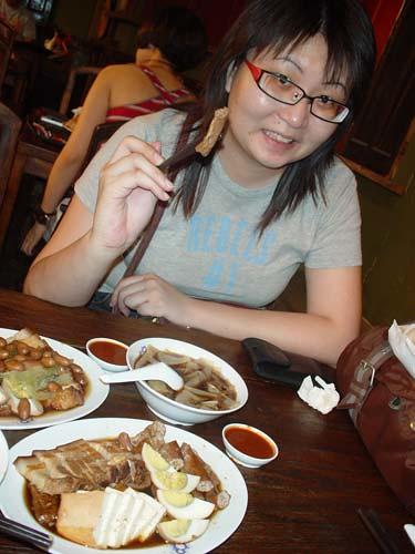 Suanie eating kuay chap
