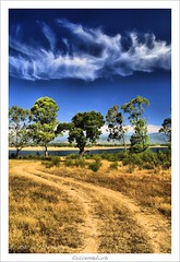 Extremadura Cloud (HaukeSteinberg.com) Tags: trees sky cloud lake mountains rural landscape eos spain europa europe reservoir explore extremadura sigma1770 400d aplusphoto gabrielygalan fineimage platinumheartaward nov2011selection