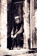One day! One day! (Habib Allahdad) Tags: door wood old portrait bw man cold male history church look hat architecture temple still eyes gate europe traditional country sunday oldman grandpa romania doormat romanian vatradornei maramures ukrain europian arhax aplusphoto ipcselection arhaxcom