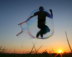Day 183 / 365  - off in my own little bubble (vvt) Tags: sunset selfportrait me field grass silhouette jump jumping dusk norfolk bubbles bubble getty groundlevel lowdown vvt burghcastle 365days cy2 challengeyouwinner