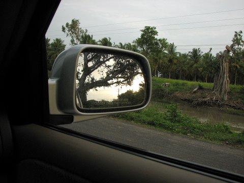sunset in the wing mirror ranganathittu