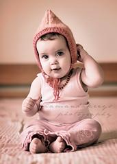In a hat, on the bed ({amanda}) Tags: baby girl hat knitting knit handknit 85mm naturallight imadethis 1year windowlight malabrigo pixiehat pinkvintage amandakeeysphotography babiesinbeaniesandhats