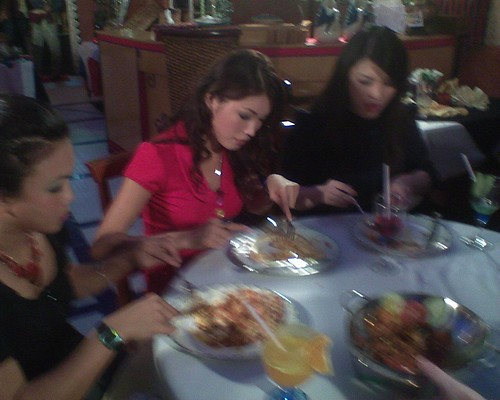 Blurry photo of Amber Chia and others during the food-tasting