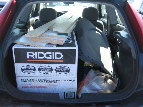 2000 Ford Focus hatchback with shopvac and lumber