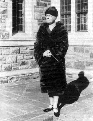Minnie A. Cumnok Blodgett in front of Blodgett Hall of Euthenics