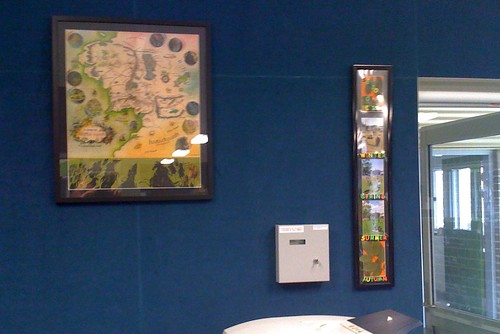 Framed Middle Earth map and photos
