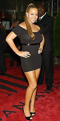 Mariah Carey works her look at BMI Urban Music Awards in New York