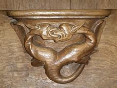 Stalles de Solignac : dragons affrontés