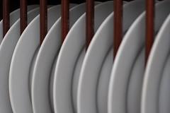 Seven Plates (EltonHarding) Tags: white lines dinner wooden raw curves 7 seven repetition plates poles repeat blueribbonwinner img3666 070707 tiltebh