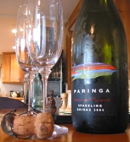 Bottle of sparkling shiraz, two champagne glasses