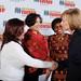 Claudia Julieta Duqua (L), Alma Guillermoprieto (2nd L) and Vicky Ntetema (2nd R) are greeted by Judy Woodruff (R)