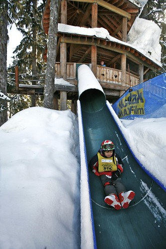 Kid on slide at Whistler (C:Toshi Kawano)