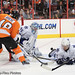 Danny Briere #48 of the Philadelphia Flyers sends the puck through the crease between J.S. Giguere #35 and Luke Schenn #2 of the Toronto Maple Leafs on October 23, 2010 at the Wells Fargo Center in Philadelphia, PA. The Flyers defeated the Maple Leafs 5-2