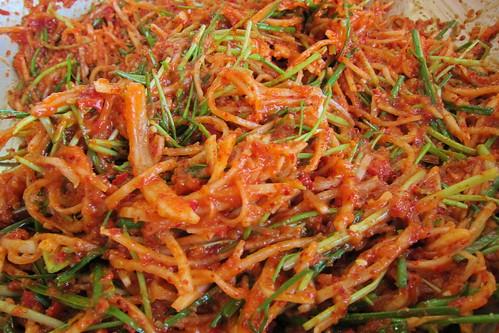 Making Kimchi: stirring the kimchi