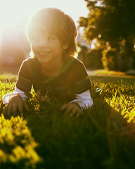 (StevanFane) Tags: old light sun tree cute smile grass canon rebel dof child natural bright florida 5 south cutie flare fl years xsi nattylight bokah