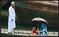 Together...we move on [..Dhaka, Bangladesh..] (Catch the dream) Tags: people motion girl look rain umbrella river boat child veil bongo hijab dhaka niqab bengal bangladesh bangla bengali bangladeshi buriganga bangali mywinners catchthedream gettyimagesbangladeshq2