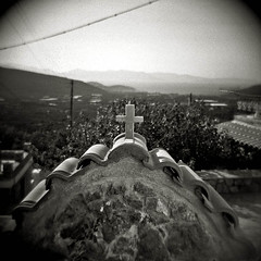 From My Elevated Position.....Monastiraki (, ) Crete. (Terrorkitten) Tags: blackandwhite 6x6 film church buildings square greek holga solitude cross secret toycamera hellas kreta slide plastic greece crete cloudless vignetting orthodox fp4 blancinegre greekorthodox cretan ilfordfp4 lasithi monastiraki lassithi stepbackintime   filmisnotdead classicblackwhite bebbington  terrorkitten   philbebbington
