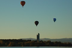 Three Balloons Above the Carillion (Leo in Canberra) Tags: autumn color colour landscape fiesta hotair balloon floating australia canberra airborne carillion balloonfestival lakeburleygriffin autumncolour