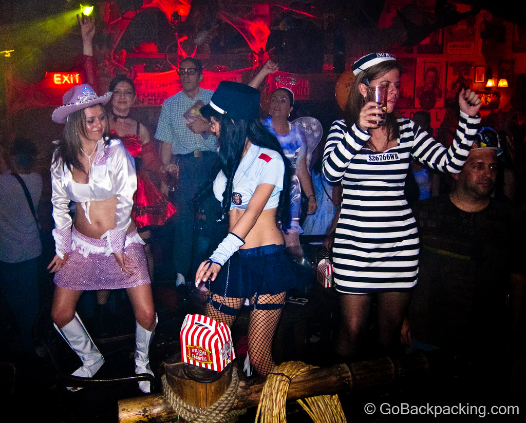 The naughty cop appears to be paying more attention to the dancing cowgirl than the escaped convict right beside her.
