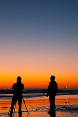 two of a kind (Eric 5D Mark III) Tags: ocean california woman seascape man color beach silhouette vertical canon landscape couple photographer tripod atmosphere orangecounty huntingtonbeach tone gradients ef24105mmf4lisusm eos5dmarkii