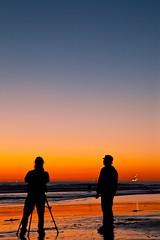 two of a kind (Eric 5D Mark III) Tags: ocean california woman seascape man color beach silhouette vertical canon landscape couple photographer tripod atmosphere orangecounty huntingtonbeach tone gradients ef24105mmf4lisusm eos5dmarkii