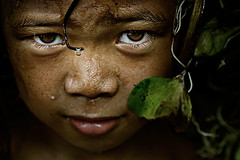 Drop (mykl mabalay) Tags: boy portrait nature water smile leaves canon leaf eyes child emotion philippines drop jungle lad stare filipino gaze pinoy mykl theface mabalay myklmabalay aplusphoto eos350dhappy